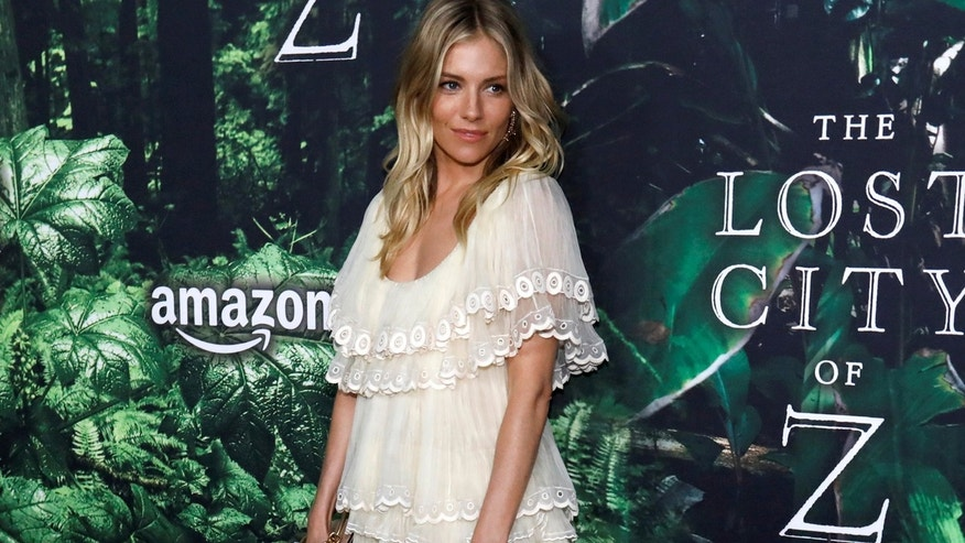 "Sienna Miller poses at the premiere of the movie ""The Lost City of Z"" in Los Angeles, California U.S., April 5, 2017."