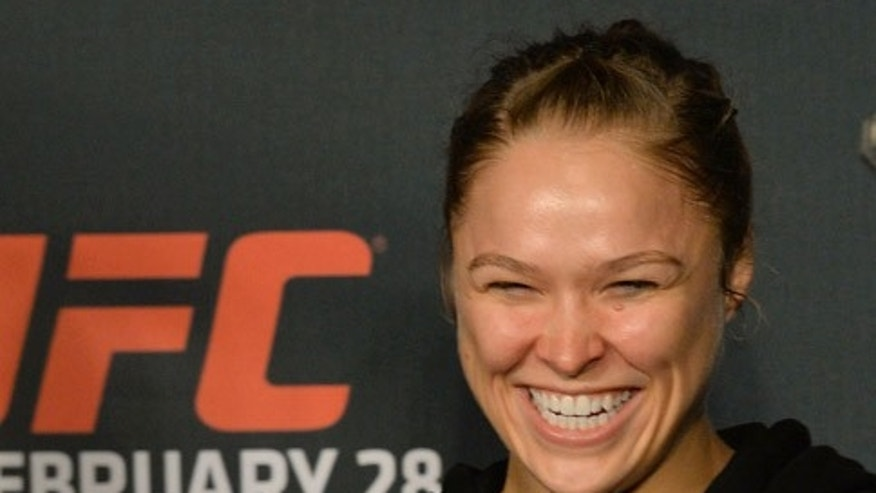 Ronda Rousey confirmed her engagement with an hilarious Instagram post.