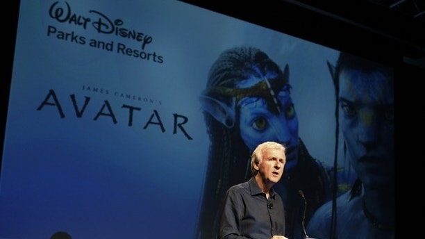 "Director James Cameron announce a long-term agreement which will bring ""Avatar"" themed lands to Disney parks with the the first at Walt Disney World in Orlando, Florida, as he speaks at a media briefing in Glendale, Calfornia September 20, 2011. A scene from ""Avatar"" is shown on screen background.  REUTERS/Fred Prouser  (UNITED STATES - Tags: ENTERTAINMENT BUSINESS)"