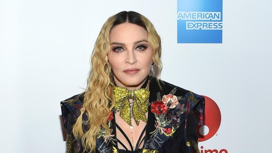 "Madonna isn't too happy about a planned biopic titled ""Blond Ambition."" Here, she is shown in a Dec. 9, 2016 file photo."
