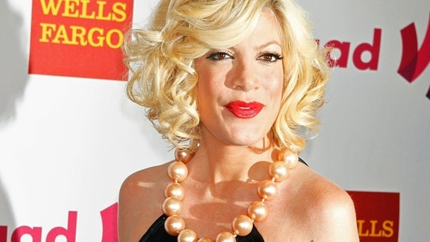 Actress Tori Spelling arrives at the 22nd annual Gay and Lesbian Alliance Against Defamation (GLAAD) Media Awards in Los Angeles, California April 10, 2011.  REUTERS/Fred Prouser  (UNITED STATES - Tags: ENTERTAINMENT) - RTR2L39R