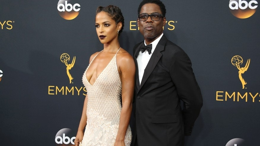 Actors Chris Rock and Megalyn Echikunwoke arrive at the 68th Primetime Emmy Awards in Los Angeles, California U.S., September 18, 2016.