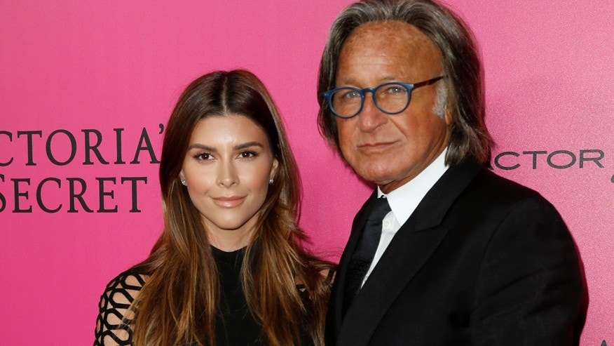 Mohamed Hadid (R) and Shiva Safai (L) pose during a photocall before the 2016 Victoria's Secret Fashion Show at the Grand Palais in Paris, France.