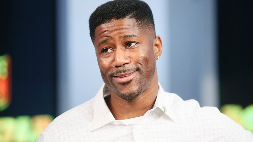 In this Sept. 9, 2015, file photo, former NFL player Nate Burleson is interviewed during a media availability on set at the at NFL Network studios in Culver City, California.