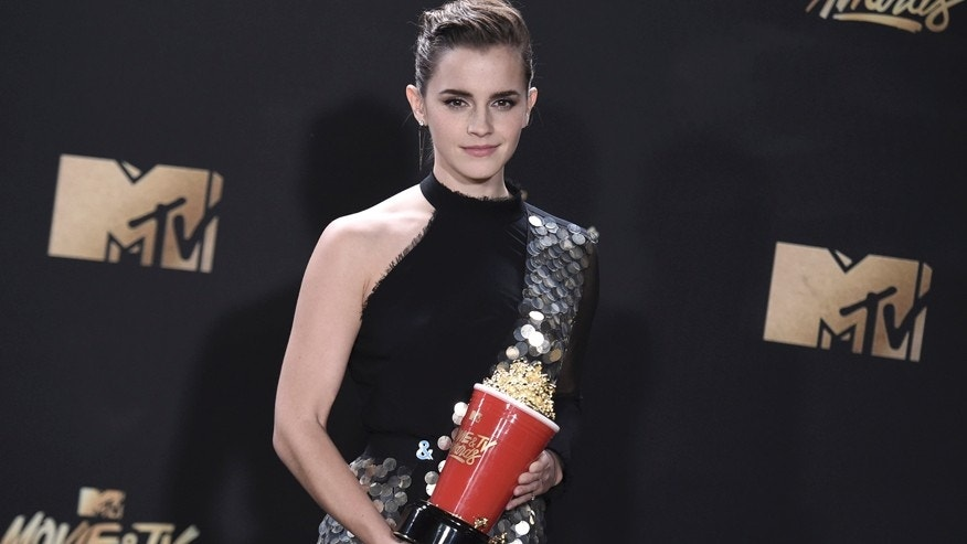 "Emma Watson poses in the press room with the award for best actor in a movie for ""Beauty and the Beast"" at the MTV Movie and TV Awards at the Shrine Auditorium on Sunday, May 7, 2017, in Los Angeles."