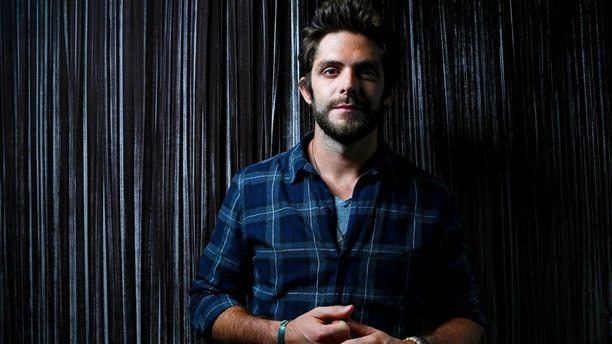 In this Sept. 15, 2015 file photo, country singer Thomas Rhett poses for a photo at Sinema Restaurant & Bar in Nashville, Tenn.