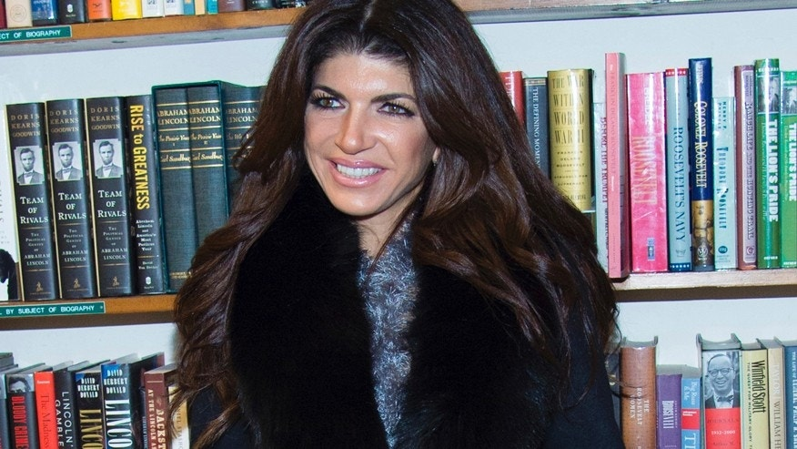 "In this Feb. 16, 2016 file photo, TV personality Teresa Giudice appears at a book signing for her new book ""Turning the Tables: From Housewife to Inmate and Back Again"" in Huntington, N.Y."