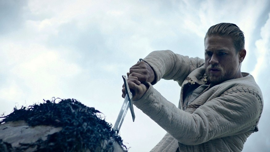 "This image released by Warner Bros. Pictures shows Charlie Hunnam in a scene from, ""King Arthur: Legend of the Sword."""