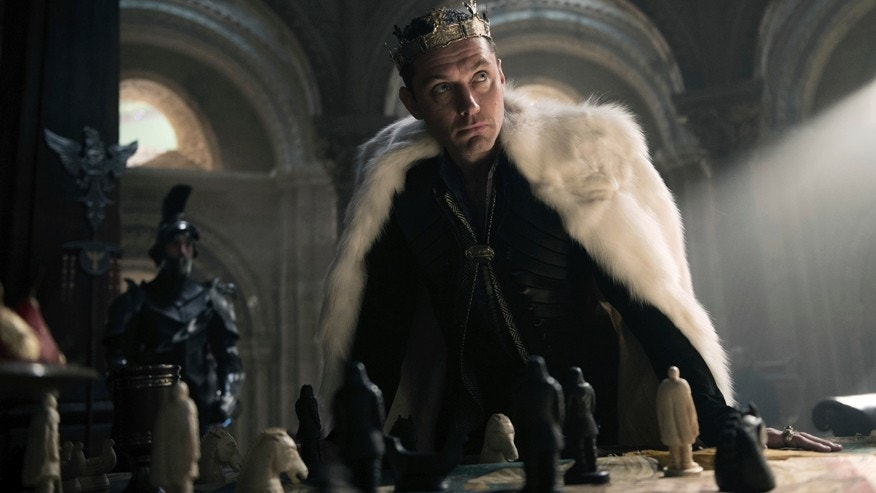 "This image released by Warner Bros. Pictures shows Jude Law in a scene from, ""King Arthur: Legend of the Sword."""
