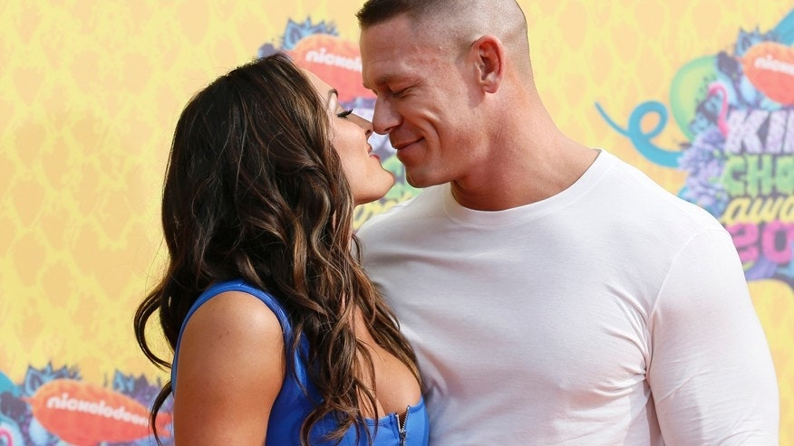 Model and wrestler Nikki Bella and WWE wrestler John Cena arrive at the 27th Annual Kids' Choice Awards in Los Angeles, California March 29, 2014.