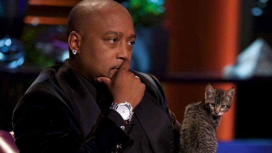 "Daymond John appears on an episode of ""Shark Tank."" He revealed on ""Good Morning America"" he had a cancerous mass removed from his thyroid."
