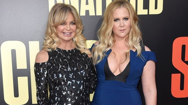 Goldie Hawn, left, and Amy Schumer arrive at the Los Angeles premiere of