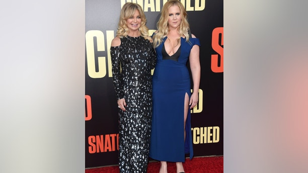 "Goldie Hawn, left, and Amy Schumer arrive at the Los Angeles premiere of ""Snatched"" at the Regency Village Theatre on Wednesday, May 10, 2017. (Photo by Jordan Strauss/Invision/AP)"