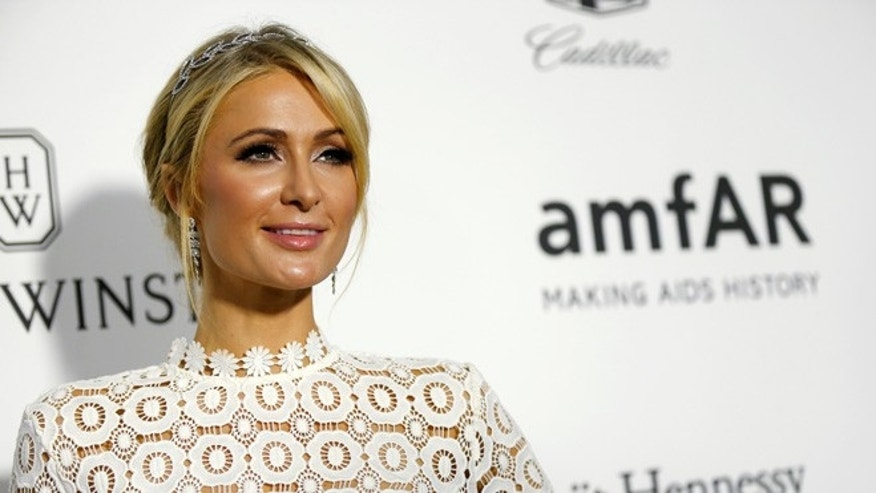 Socialite Paris Hilton poses at the 2016 amfAR Inspiration Gala in Los Angeles, California U.S., October 27, 2016. REUTERS/Mario Anzuoni - RTX2QSGQ