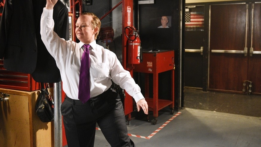 This May 9, 2017 photo provided by NBC Universal shows Melissa McCarthy as Shawn Spicer posing for promos for Saturday Night Live backstage in New York. McCarthy will host the show this weekend.