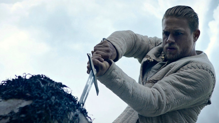 "This image released by Warner Bros. Pictures shows Charlie Hunnam in a scene from, ""King Arthur: Legend of the Sword."" (Warner Bros. Pictures via AP)"