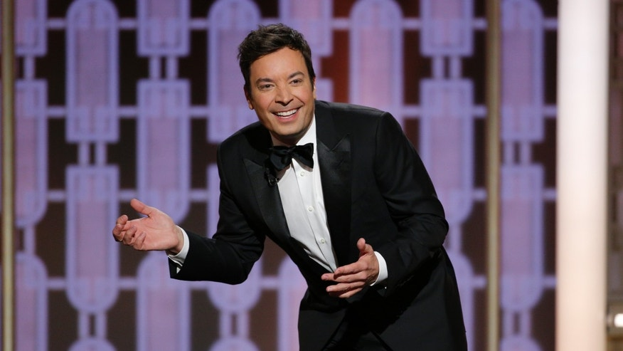 This image released by NBC shows host Jimmy Fallon at the 74th Annual Golden Globe Awards held at the Beverly Hilton Hotel on Sunday, Jan. 8, 2017. (Paul Drinkwater/NBC via AP)