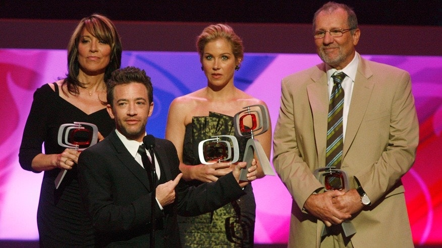 "Cast members of ""Married With Children"" (L-R) Katey Sagal, David Faustino, Christina Applegate and Ed O'Neill accept the Innovator award at the taping of the seventh annual TV Land Awards in Los Angeles."