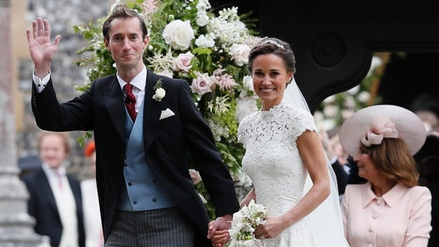 Pippa Middleton and James Matthews smile after their wedding.