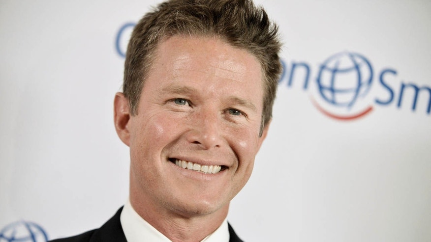 FILE - In this Sept. 19, 2014 file photo, Billy Bush arrives at the Operation Smile's 2014 Smile Gala in Beverly Hills, Calif.