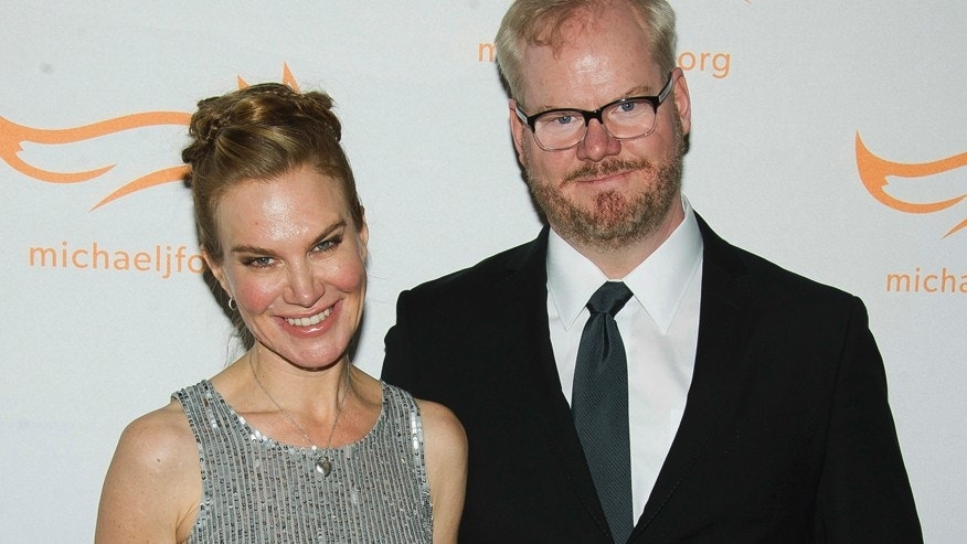 "In this Nov. 22, 2014 file photo, Jeannie Gaffigan, left, and Jim Gaffigan attend The Michael J. Fox Foundation for Parkinson's Research benefit, ""A Funny Thing Happened on the Way to Cure Parkinson's,"" in New York. Gaffigan says his wife and writing partner Jeannie is recovering after surgery to remove a serious brain tumor."