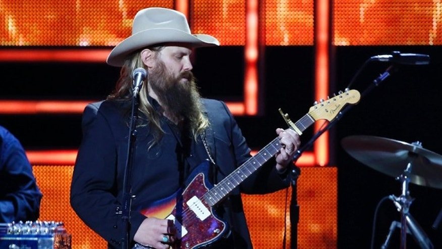 In this Dec. 2, 2015, file photo, Chris Stapleton performs at the 2015 Artists of the Year Show at Schermerhorn Symphony Center in Nashville, Tenn.