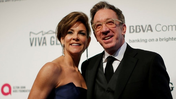 Actors Tim Allen and Jane Hajduk pose for photographers at the 2017 Elton John AIDS Foundation Academy Awards Viewing Party in Los Angeles, California, U.S., February 26, 2017.   REUTERS/Brian Snyder - RTS10HVI
