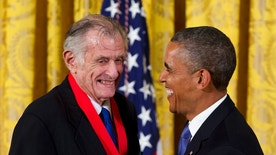 "FILE - In this July 10, 2013, file photo, President Barack Obama laughs with Frank Deford as he awards him the 2012 National Humanities Medal during a ceremony in the East Room of White House in Washington. Deford gave his final sports commentary on NPR's ""Morning Edition"" Wednesday, ending a run of what he calls ""little homilies"" that began in 1980.  (AP Photo/Carolyn Kaster, File)"