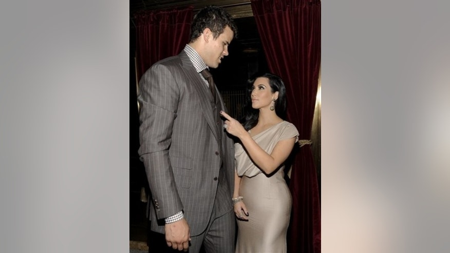 Newlyweds Kim Kardashian and Kris Humphries attend a party thrown in their honor at Capitale on Wednesday, Aug. 31, 2011 in New York. (AP Photo/Evan Agostini)