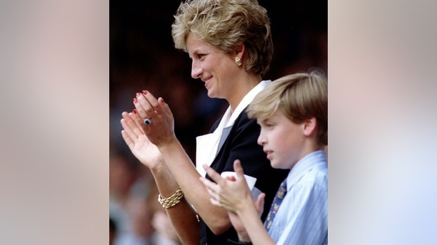 Diana, Princess of Wales, with son Prince William, applaud the prize-giving ceremony for the Ladies Singles final at the Wimbledon.