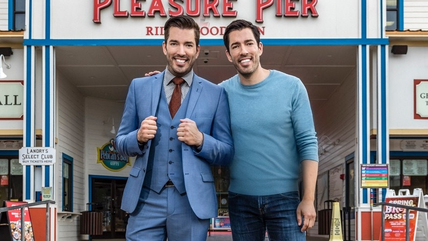 "After losing the living room and dining room renovation challenge, host Jonathan Scott is forced to ride the Revolution at Pleasure Pier while Drew Scott watches and taunts him as seen on ""Brother vs. Brother."""