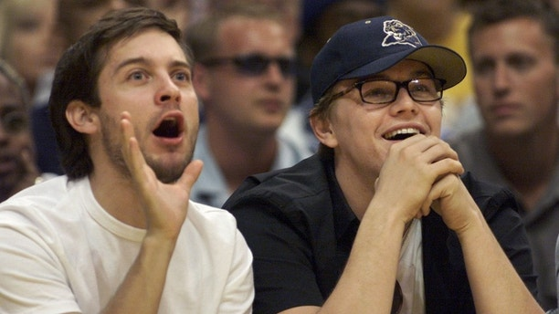 Actors Tobey Maguire (L) and Leonardo DiCaprio take in Game 1 of the NBA Western Conference finals between the Los Angeles Lakers and the Portland Trail Blazers May 20 in Los Angeles. The two actors sat courtside for the game and watched Los Angeles defeat Portland 109-94.