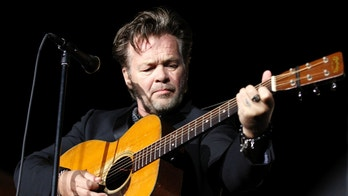 Singer John Mellencamp performs at an Obama-Biden campaign rally in Richmond, Virginia November 5, 2012. U.S. President Barack Obama and Republican challenger Mitt Romney are essentially tied on the eve of Election Day, but the Democrat has a slight edge in some of the pivotal states where the election will be decided, according to Reuters/Ipsos polling released on Monday.  REUTERS/Kevin Lamarque  (UNITED STATES - Tags: POLITICS ELECTIONS USA PRESIDENTIAL ELECTION ENTERTAINMENT) - RTR3A1GA