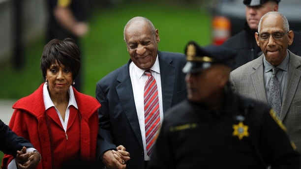 """Bill Cosby arrives with actress Sheila Frazier, left, and Frazier's husband John Atchison, a celebrity hairstylist, for his sexual assault trial at the Montgomery County Courthouse in Norristown, Pa., Wednesday, June 7, 2017. Cosby and Frazier were on screen together in the 1978 comedy """"California Suite."""" Atchison's client roster includes Cosby and his wife, Camille."""