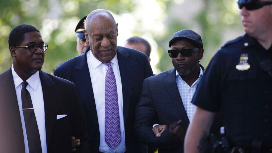 Bill Cosby arrives with Comedian Joe Torry, second from right, for his sexual assault trial at the Montgomery County Courthouse in Norristown, Pa., Friday, June 9, 2017.