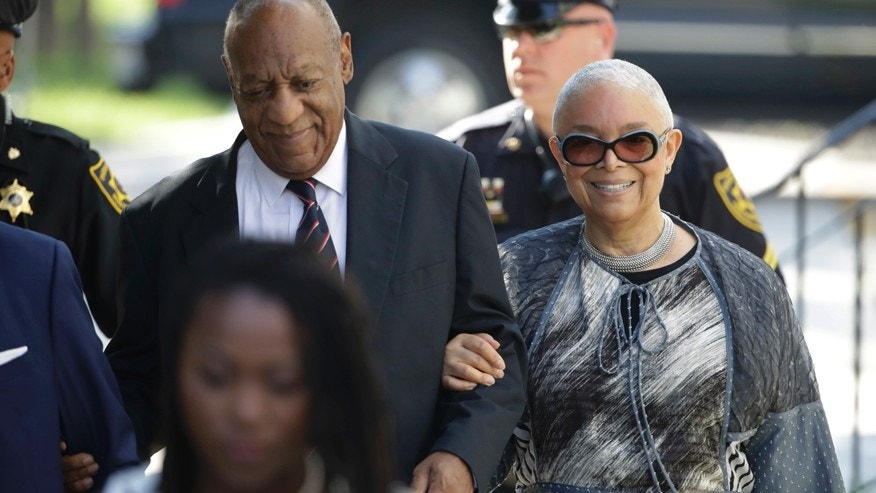 Bill Cosby arrives for his sexual assault trial with his wife Camille Cosby right at the Montgomery County Courthouse in Norristown Pa. Monday