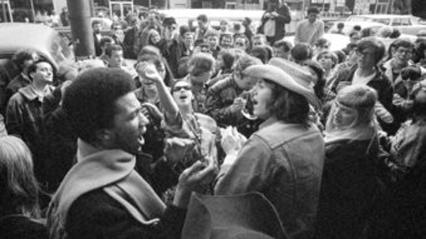 FILE - In this April 13, 1967 file photo, people gather in the Haight-Ashbury district in San Francisco. In 2017's Haight-Ashbury neighborhood, which had been ground zero for the counterculture, two-bedroom apartments now rent for $5,000 a month. San Francisco remains a magnet for young people, but even those earning six-figure Silicon Valley salaries complain about the cost of living. (AP Photo/Robert W. Klein, File)