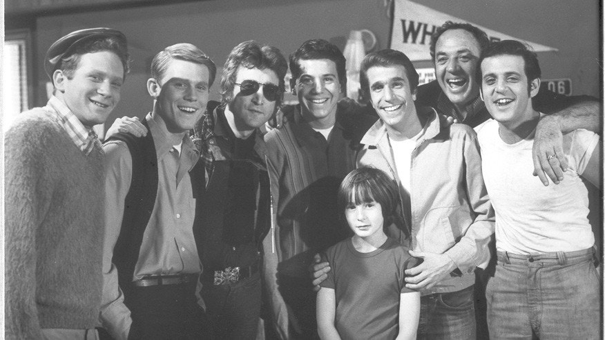 "Anson Williams (center) poses with John Lennon and the rest of his ""Happy Days"" cast."