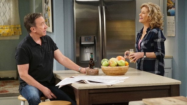 "Tim Allen (left) and Nancy Travis in ""Last Man Standing."""