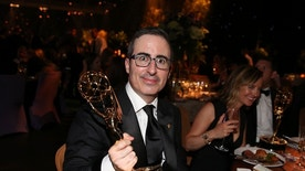 "John Oliver holds his award for Outstanding Variety Talk Series for ""Last Week Tonight With John Oliver"" at the Governors Ball after the 68th Primetime Emmy Awards in Los Angeles, California U.S., September 18, 2016.  REUTERS/Lucy Nicholson - RTSOCTG"