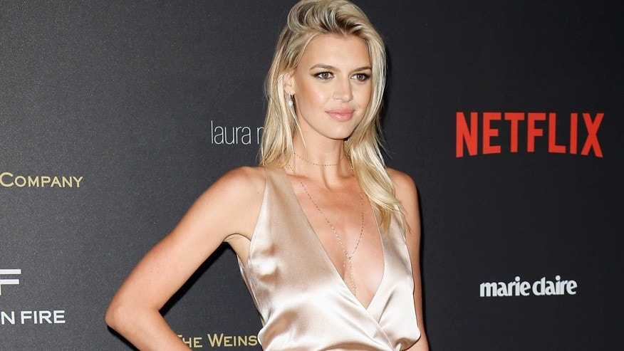 Model Kelly Rohrbach arrives at The Weinstein Company & Netflix Golden Globe After Party in Beverly Hills, California January 10, 2016.