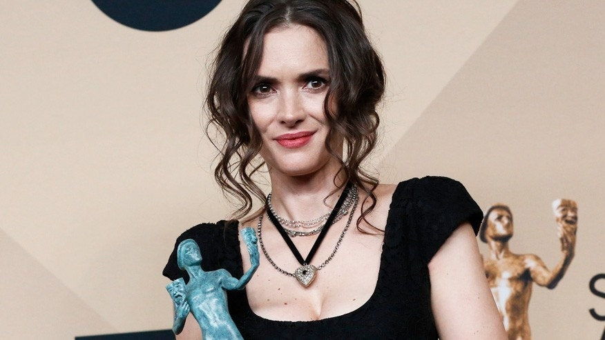 "Actress Winona Ryder poses with the award she won for Outstanding Performance by an Ensemble in a Drama Series for her role in ""Stranger Things"" backstage at the 23rd Screen Actors Guild Awards in Los Angeles, California, U.S., January 29, 2017."
