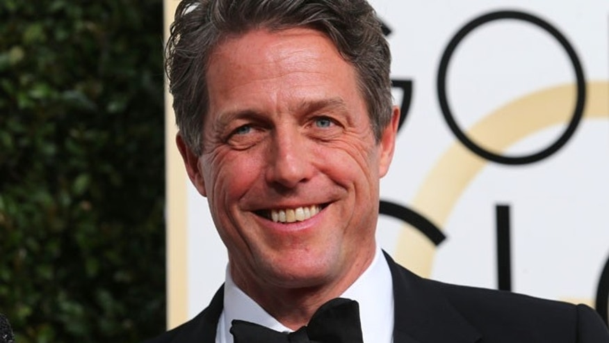 FILE: Actor Hugh Grant arrives at the 74th Annual Golden Globe Awards in Beverly Hills.