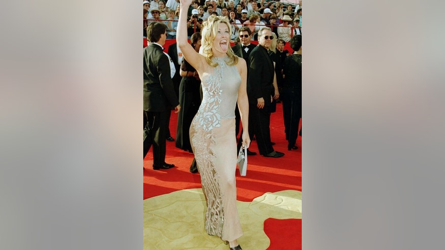 MTV personality Jenny McCarthy arrives at the Shrine Auditorium for the 69th annual Academy Awards, March 24, 1997.