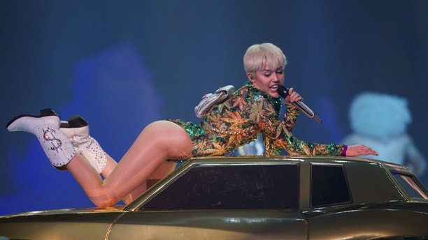 CORRECTS NAME OF CONCERT - Miley Cyrus performs during the opening show of the Bangerz Tour, on Friday Feb. 14, 2014 in Vancouver, Canada. (Photo by STEPHEN BRASHEAR/Invision/AP)