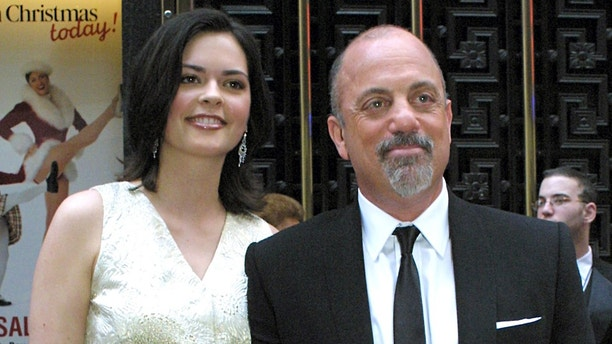 Billy Joel and his girlfriend Kate Lee arrive for the 57th  Annual Tony Awards at Radio City Music Hall, Sunday, June 8, 2003, in New York. (AP Photo/Tina Fineberg)