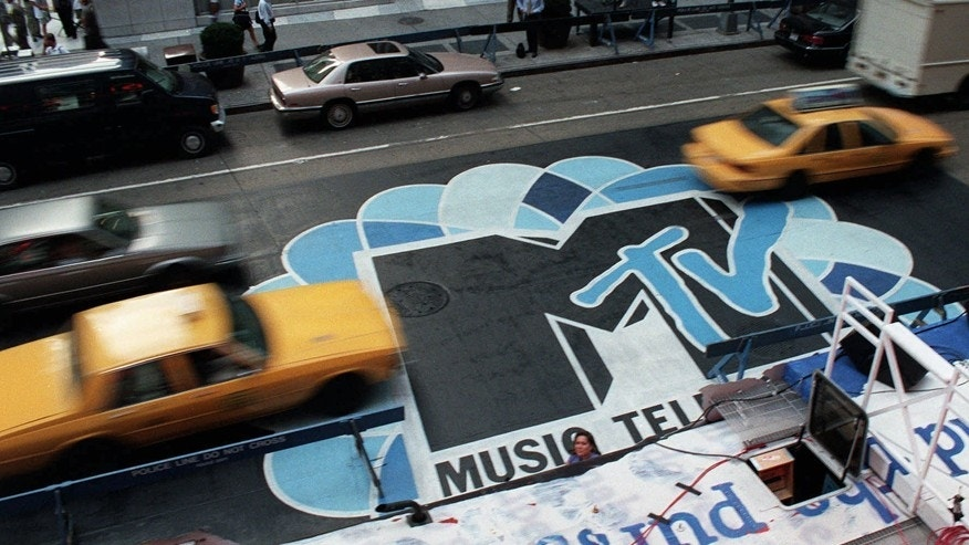 "In this Sept. 3, 1996, file photo, traffic moves along 6th Avenue in New York, over the logo painted in the street outside Radio City Music Hall for the MTV Music Video Awards ceremony. MTV said it doesn't condone driving under the influence after a cast member was shown nodding off behind the wheel during the most recent episode of ""Teen Mom OG"" that aired June 26, 2017."
