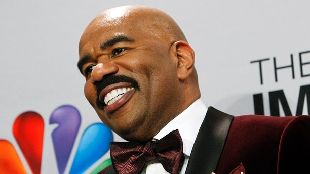 Host Steve Harvey smiles as he poses in the media room at the 44th NAACP Image Awards at the Shrine Auditorium in Los Angeles, California, February 1, 2013. REUTERS/Patrick T. Fallon (UNITED STATES - Tags: ENTERTAINMENT SOCIETY) - RTR3D9BS