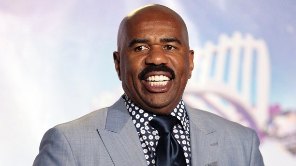 Television personality Steve Harvey poses with the BET humanitarian award he received at the 2011 BET Awards in Los Angeles June 26, 2011.    REUTERS/Jason Redmond (UNITED STATES - Tags: ENTERTAINMENT) - RTR2O599