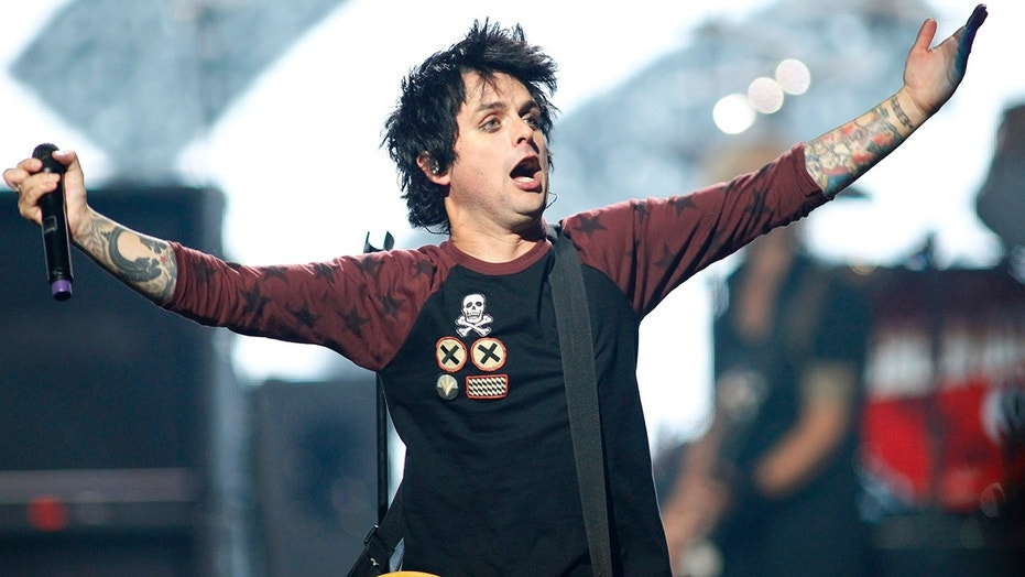 Green Day lead vocalist and guitarist Billie Joe Armstrong performs with the group during the 2012 iHeart Radio Music Festival in Las Vegas, Nevada September 21, 2012.